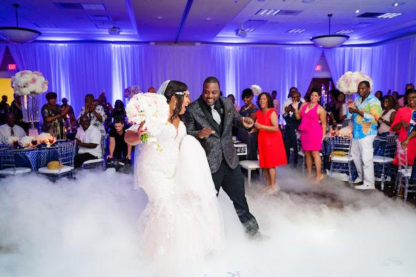 bride and groom entering their Doko Manor ballroom and dancing on a cloud of smoke