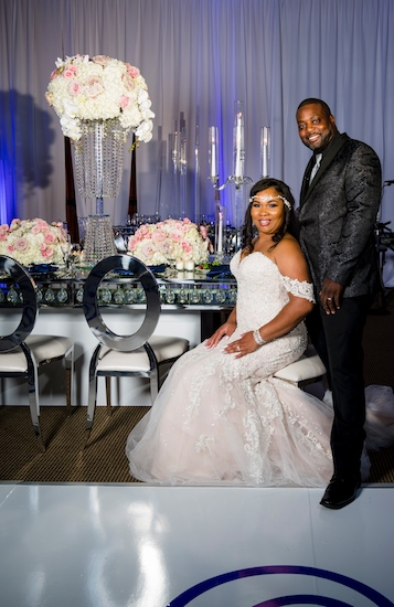bride and groom posing for photos at their sophisticated Doko Manor wedding