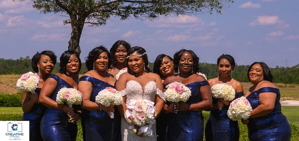 bridal party wearing shimmering Navy blue sequin dresses posing with bride