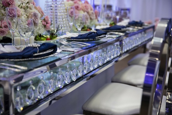 crystals hanging on a long mirrored dining table at a sophisticated South Carolina wedding