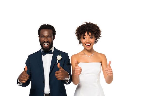 happy black bride and groom giving a thumbs up