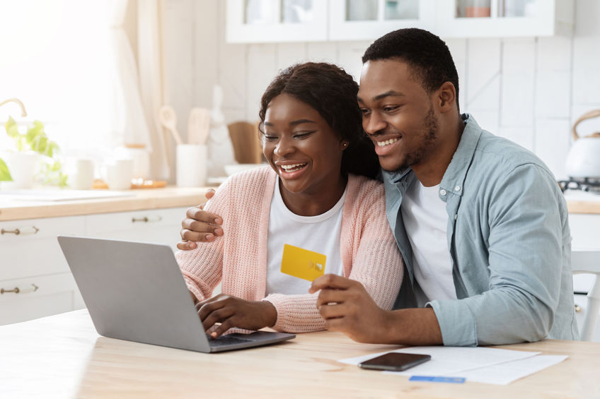 young black couple on video conference with wedding planner