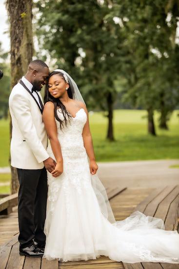 brid mand groom posing for photos after their North Charleston wedding