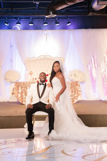 Sophisticated Affairs bide and groom posing for photos at their North Charleston wedding reception