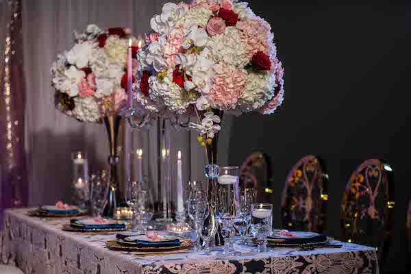 long wedding reception tables with embroidered line and tall blush and burgundy centerpieces