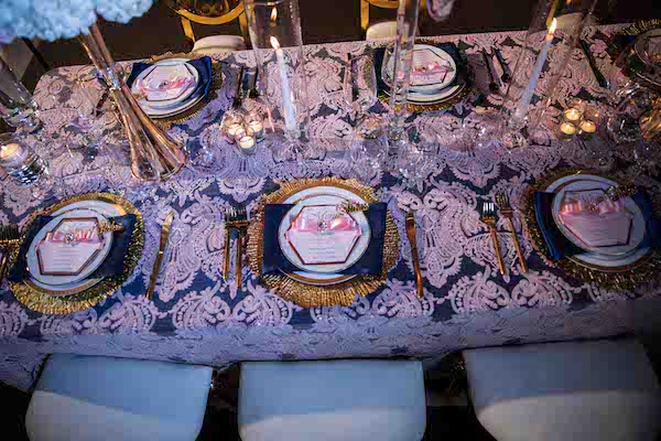 luxurious North Charleston wedding reception set with gold charger plates and eclectic gold rimmed china