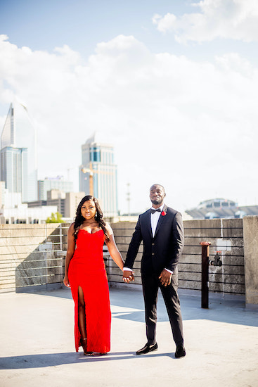 bride and groom to be all dressed up for rooftop engagement photos