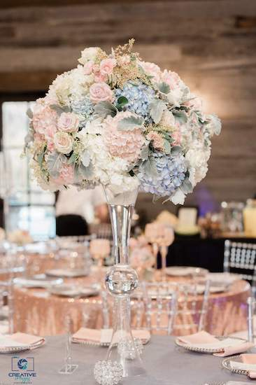 blush and dusty blue centerpiece at a catawba falls event center wedding