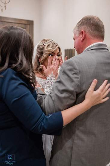 bride having a touching moment with her father before her wedding ceremony