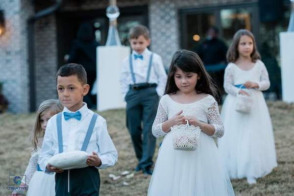 ring bearers and flower girls in dusty blue